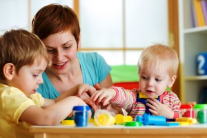 kids and mother playing colorful clay toy